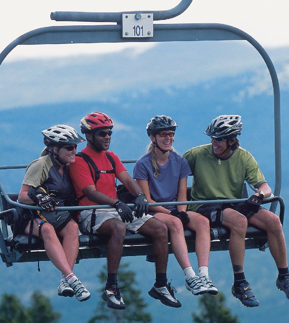 mountain bikers on chair lift
