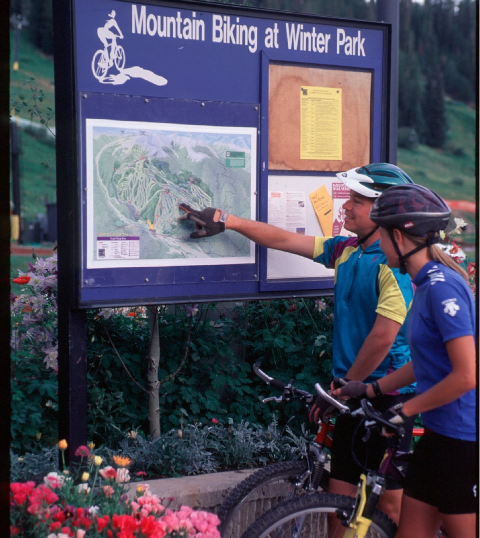 couple mountain biking at winter park