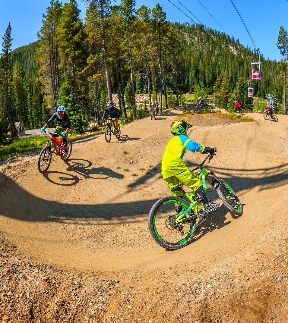 mountain bikers on pump track